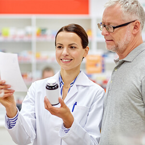 Man talking with pharmacist
