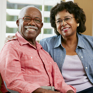 Smiling older black couple